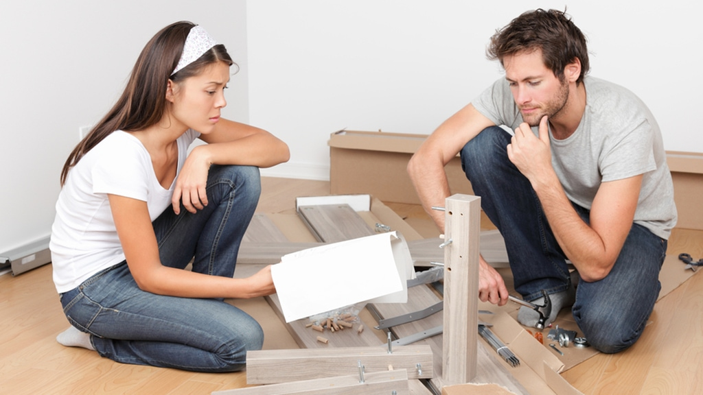 Couple assembles Ikea furniture