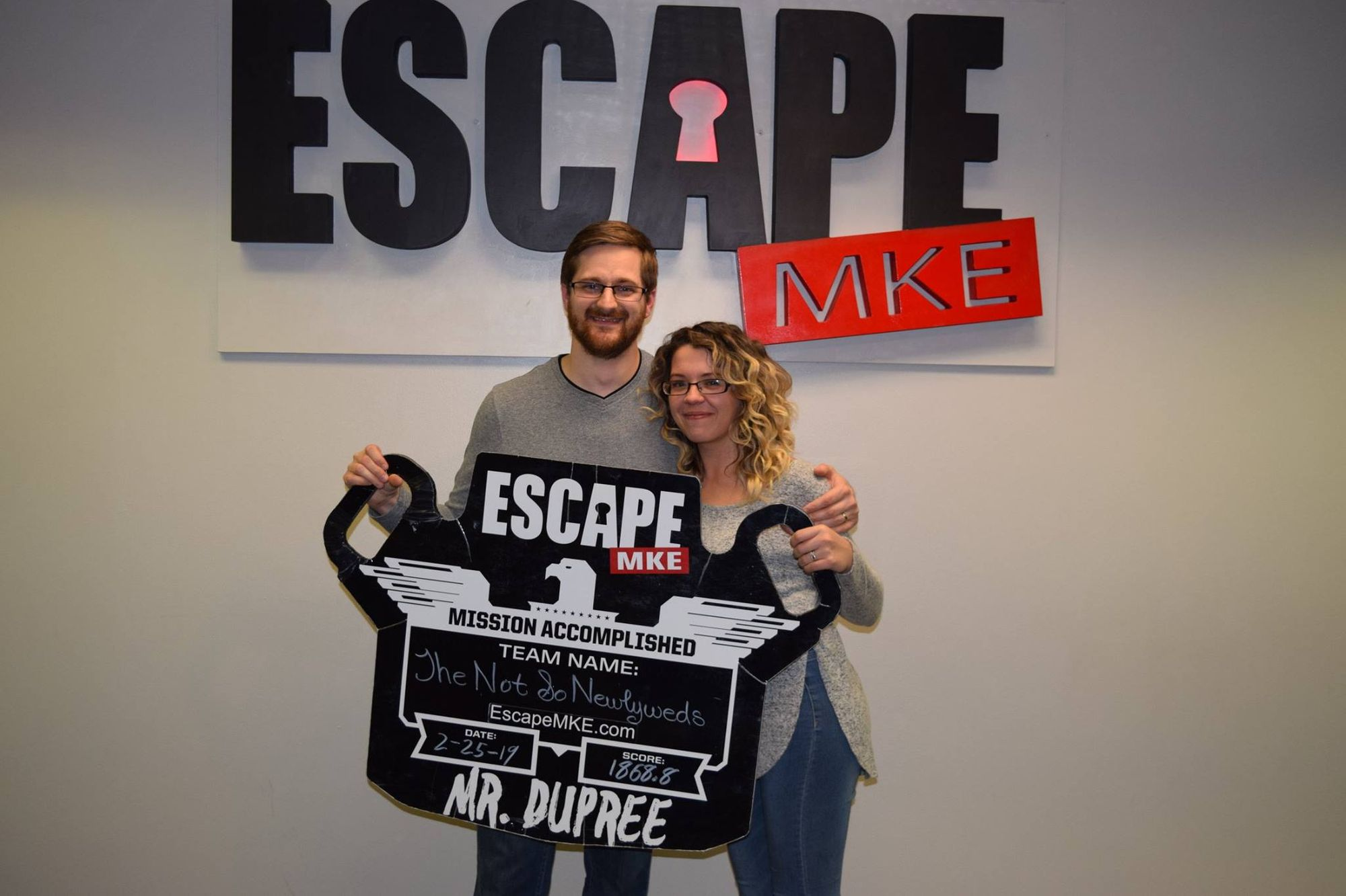 Couple having a lovely time in an escape room