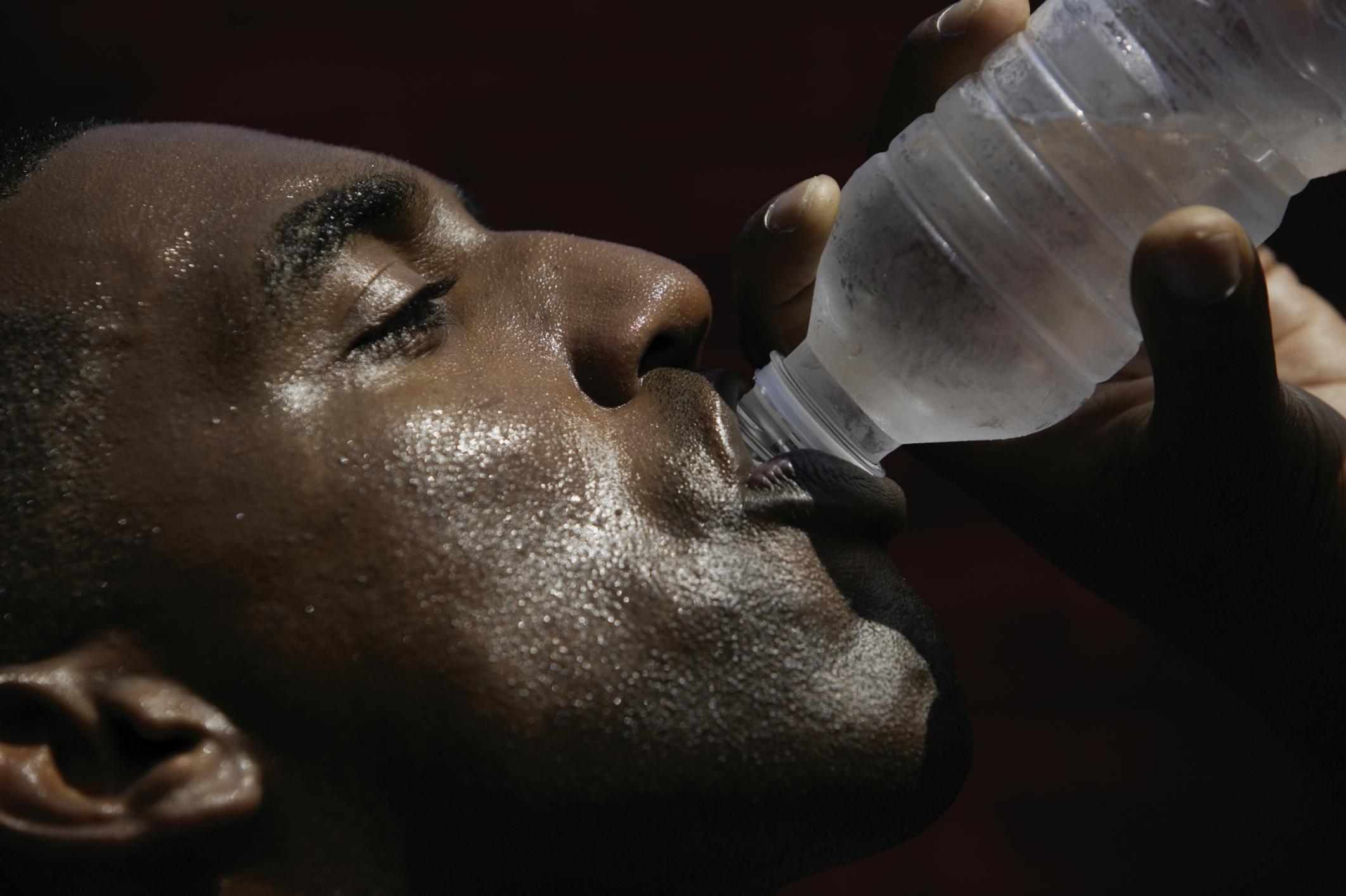 Sweaty man drinking water